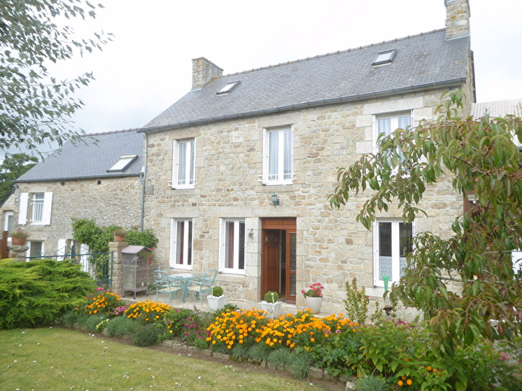 Elegant Farmhouse style home & gite on beautiful garden with trees and flowers.